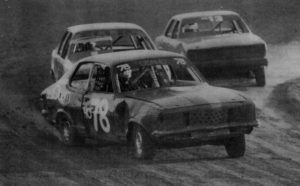 ROUNDING A TURN: Street stock cars race around a bend during a heat at Blue Ribbon Raceway. Dean Thomas, in car number 78, leads his fellow Horsham drivers Steve Ellis and Gavin Puis into the straight. PHOTO: Paul Carracher
