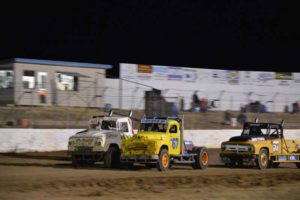 V8 TRUCKS: Wes Bell, Jaryd Carman drag down the home straight with Luke James is hot pursuit PHOTO: Mark Cowin