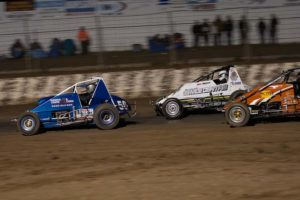 WINGLESS SPRINT CARS: Ashley Armistead leads Jack Oliver into the turn. PHOTO: Emma Bansemer