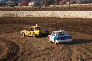 FOLLOW THE LEADER: Three Litre / Modified Production driver, Steve Ellis shows rookie Street Stock driver, Jamie Collins how it's done. PHOTO: Paul Flach