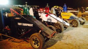 The cars of Jock Baker, Adrian Christian and Adam Mackenzie adorned with the winning trophies.