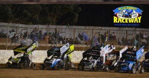 FOUR WIDE: Formula 500 drivers perform a four-wide salute to the speedway fans that came out to watch in the cold conditions. PHOTO: Mark Cowin