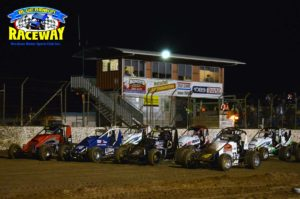 FOUR WIDE WINGLESS: Feature race drivers perform a Four-wide salute to the race fans before the race. PHOTO: Leanne Shanks