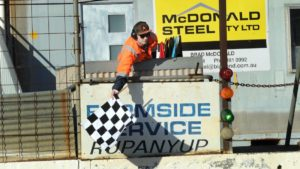 Flagman Dylan Simpson at Blue Ribbon Raceway. PHOTO: WImmera Mail TImes