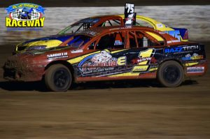 PRESSURE: Street Stock Drivers Brad McClure and Kathryn Wilken battle it out in the turn. PHOTO: M & L Speedway Photography