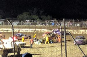 UPSIDE DOWN: Track Marshalls and safety crew tend to Kathryn Jackson after she rolled her car. PHOTO: Stuey Robinson
