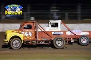 V8 TRUCKS: Steven Hately challenges the #44 V8 Truck of Fletcher Mills. PHOTO: M& L Speedway Photography