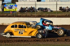 VINTAGE: Jamie Pridham gets up close and under the wheel of Dave Monaro. PHOTO: M&L Speedwawy Photography